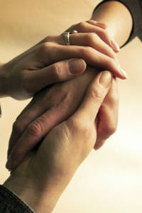 spiritual healing with holding hands sharing love on the road to recovery